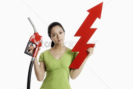Spending money : Woman holding a red petrol pump and an up arrow