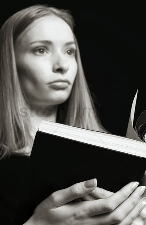 Composed : Woman holding an opened book