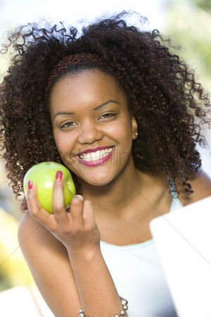 Head shot : Woman holding apple