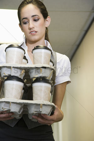Interior : Woman holding coffee cups