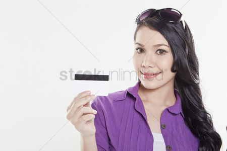 free woman holding card stock vectors stockunlimited