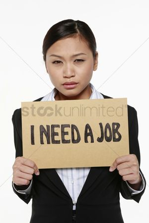 Unemployment : Woman holding placard with text  i need a job