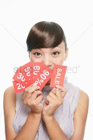 Shopping background : Woman holding sale signs