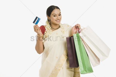 Spending money : Woman holding shopping bags and a credit card