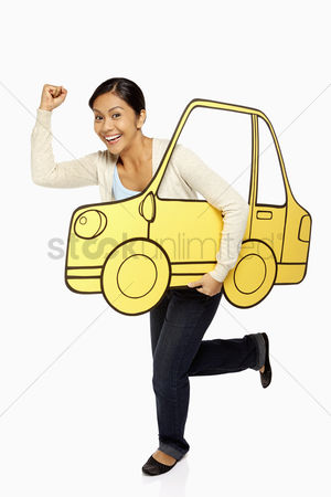 Bidayuh ethnicity : Woman holding up a cardboard car  cheering
