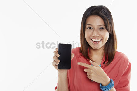 Cheerful : Woman holding up mobile phone