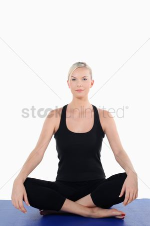 Practising yoga : Woman in fitness clothing