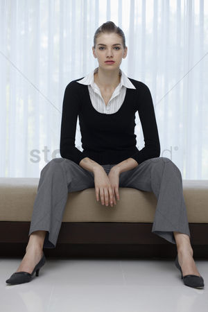 Composed : Woman in formal wear posing for the camera