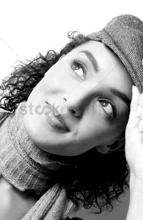 Wondering : Woman in hat smiling while thinking