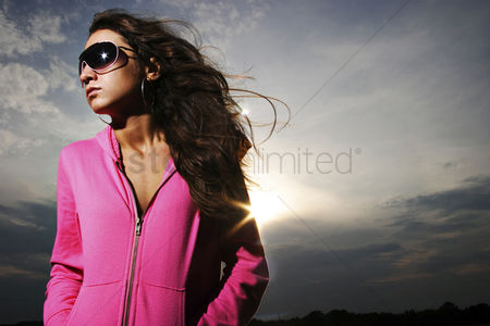 Fashion : Woman in pink jacket and sunglasses