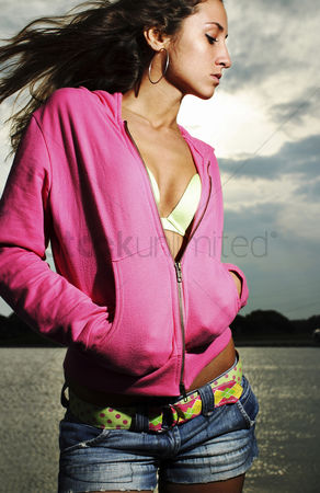 Fashion : Woman in pink jacket posing for the camera