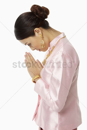 Traditional clothing : Woman in traditional clothing bowing her head