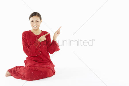 Traditional clothing : Woman in traditional clothing showing hand gesture