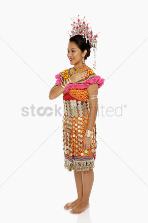 Bidayuh ethnicity : Woman in traditional clothing showing hand greeting gesture