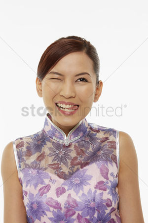 Lunar new year : Woman in traditional clothing sticking out her tongue