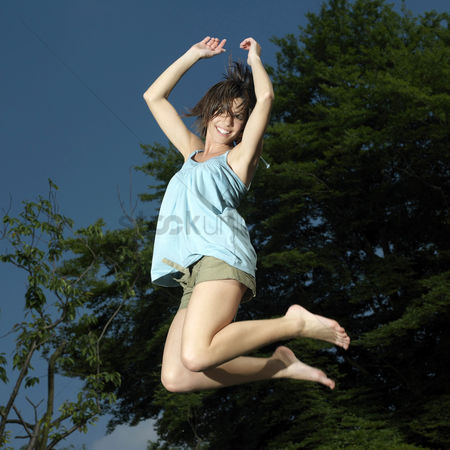 Excited : Woman jumping in the air