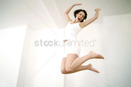 Enjoying : Woman jumping up in joy