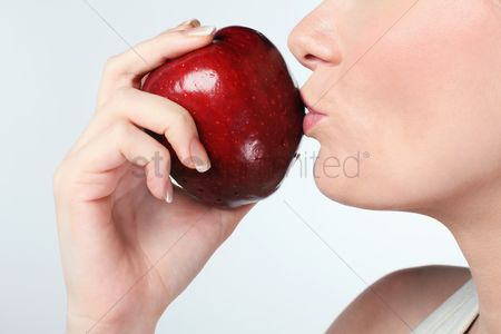 British ethnicity : Woman kissing red apple