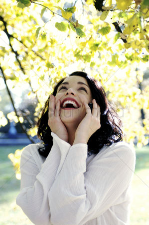 Smile : Woman laughing while talking on the hand phone