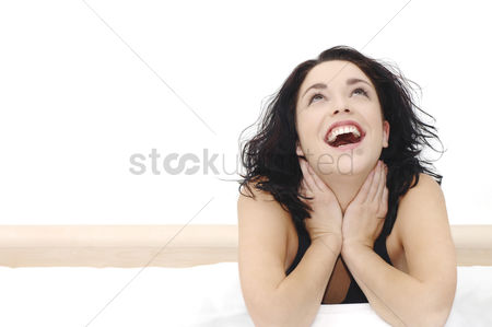 Lying forward : Woman laughing
