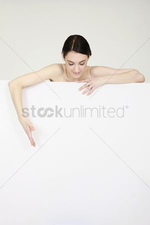 Cardboard cutout : Woman leaning over blank placard
