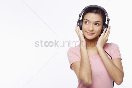 Color image : Woman listening to music through the headphone