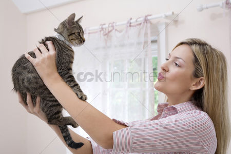 Animal head : Woman looking at her cat