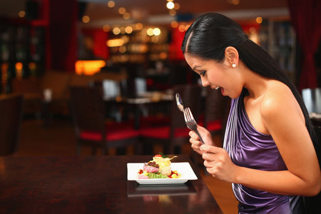 Indulgence : Woman looking happily at her food