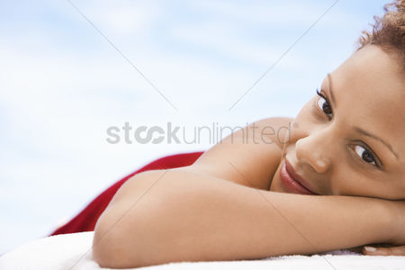 Club : Woman lying on massage table head and shoulders close up