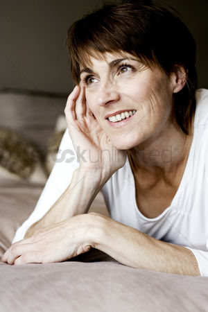 Lying forward : Woman lying on the bed thinking