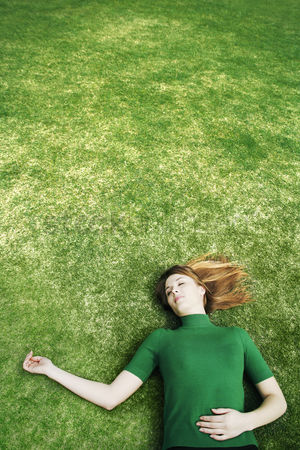Grass : Woman lying on the field