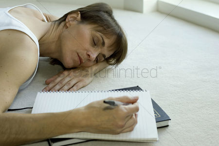 Pen : Woman lying on the floor sleeping with pen in her hand