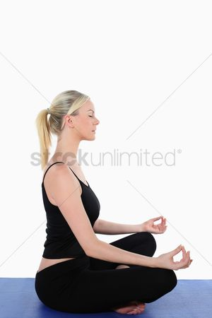 Practising yoga : Woman meditating