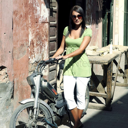 Sunny : Woman posing with motorcycle