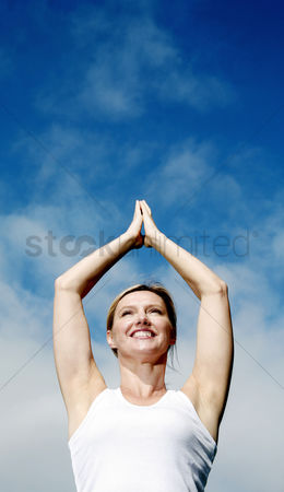 Rest : Woman practicing yoga