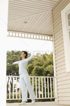 Practising yoga : Woman practising yoga on the porch