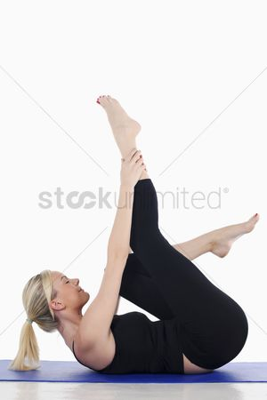 British ethnicity : Woman practising yoga