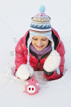 Cold temperature : Woman putting coin into piggy bank