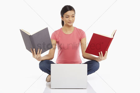 Portability : Woman reading while using laptop