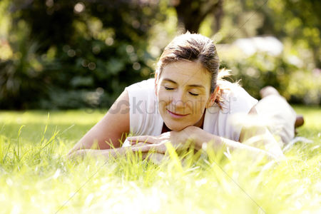 Grass : Woman relaxing in the park