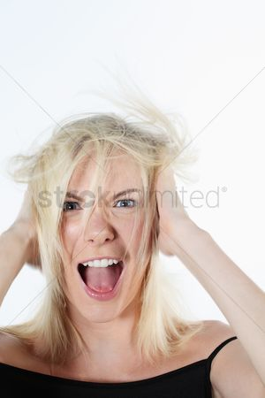 British ethnicity : Woman screaming with hands on head