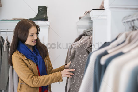 Shopping background : Woman selecting sweater in store