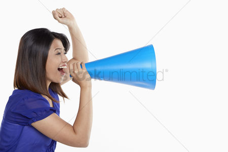 Cheerful : Woman shouting into a megaphone