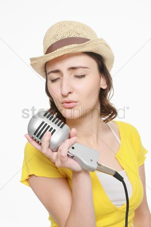 Vintage : Woman singing into microphone