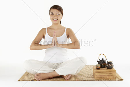 Tea pot : Woman sitting and meditating