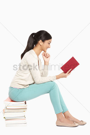 Malaysian indian : Woman sitting and reading a book