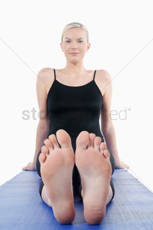 Practising yoga : Woman sitting on yoga mat