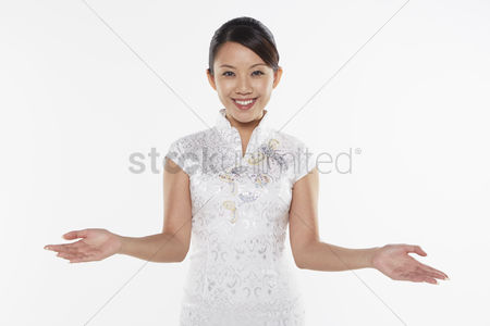 Lunar new year : Woman smiling and showing hand gesture