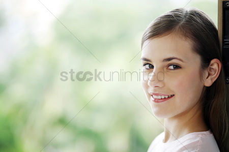 Satisfaction : Woman smiling at the camera