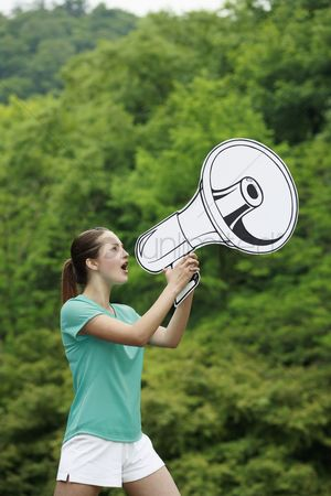Cardboard cutout : Woman speaking through megaphone